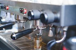 Prepares espresso in his coffee shop royalty free stock images