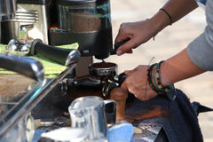 Prepares espresso in his coffee shop. Leather bracelets Royalty Free Stock Photography