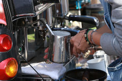 Prepares espresso in his coffee shop. Leather bracelets Royalty Free Stock Image