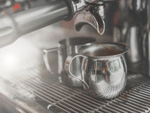 Prepares espresso in his coffee shop royalty free stock image