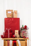 Preparing advent calendar and packing christmas gifts in red col Royalty Free Stock Photos