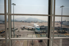 Preparing of airplane for flight in Hong Kong Airport Royalty Free Stock Photo