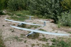Preparing the army drones for the mission. A pair of reconnaissance aircraft in the wild. Preparing the army drones for the mission. A pair of reconnaissance stock photo