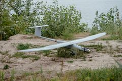 Preparing the army drones for the mission. Reconnaissance aircraft in the wild. Preparing the army drones for the mission. Reconnaissance aircraft in the wild royalty free stock photo