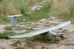 Preparing the army drones for the mission. Reconnaissance aircraft in the wild. Preparing the army drones for the mission. Reconnaissance aircraft in the wild stock photo