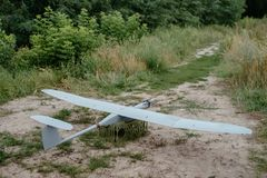 Preparing the army drones for the mission. Reconnaissance aircraft in the wild. Preparing the army drones for the mission. Reconnaissance aircraft in the wild stock photography