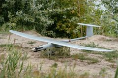 Preparing the army drones for the mission. Reconnaissance aircraft in the wild. Preparing the army drones for the mission. Reconnaissance aircraft in the wild stock images