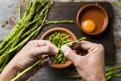 Preparing an asparagus omelet Stock Photos