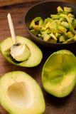 Preparing avocado salad Stock Images