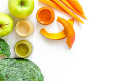 Preparing baby food. Broccoli, pumpkin, apple puree on white background top view copyspace Royalty Free Stock Images