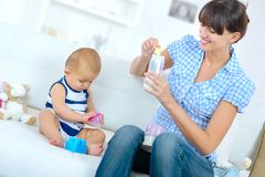 Preparing the baby formula. Work stock image