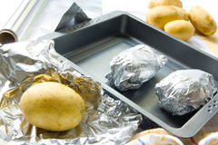 Preparing baked potatoes Royalty Free Stock Images