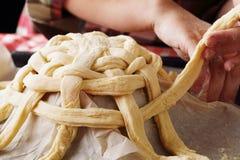 Preparing baking basket from dough Royalty Free Stock Images