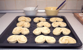 Preparing for baking small buns from dough Royalty Free Stock Photo