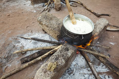 Preparing banku on a fire, Africa Stock Photo