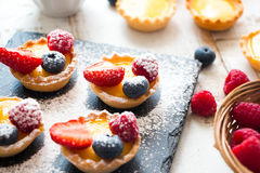 Preparing berries tartlets Stock Photography
