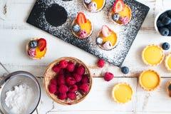 Preparing berries tartlets Stock Photo