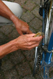 Preparing the bike. Older man working on his bicycle Royalty Free Stock Photo