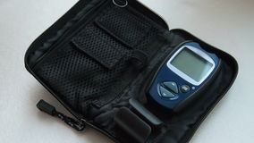 Preparing for blood sugar test with home glucometer stock video footage