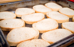 Preparing bread slices for sandwiches and greasing and frying Royalty Free Stock Images