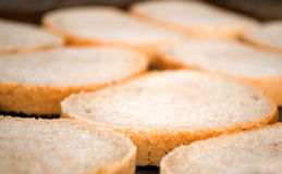 Preparing bread slices for sandwiches and greasing and frying Royalty Free Stock Photo