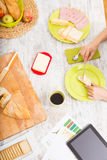 Preparing breakfast while getting online information about nutri Stock Photography