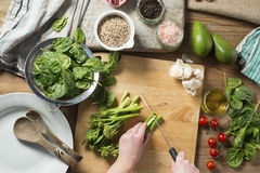 Preparing Brocolli, Spinach Quinoa Salad Stock Photos