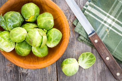 Preparing brussels sprouts for the evening meal Royalty Free Stock Images