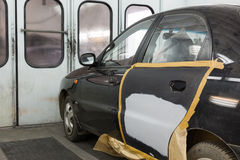 Preparing the car for painting on body shop Royalty Free Stock Photo