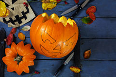 Preparing a carved pumpkin for halloween, tinker autumn decorati. On on a blue rustic wooden table, copy space, selected focus Stock Photography