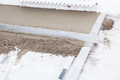 Preparing a cement screed Royalty Free Stock Photos