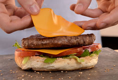 preparing cheese  burger. Stock Images