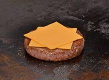 Preparing cheese  burger. Royalty Free Stock Photo