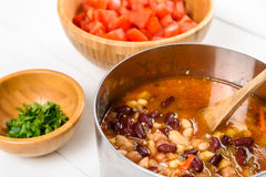 Preparing Chili Bean Stew On Wood Kitchen Table Royalty Free Stock Photography