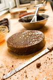 Preparing chocolate cake with filling Royalty Free Stock Photography