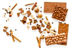 Preparing chocolate. Chocolate bars, nuts, cinnamon on white background top view copyspace Stock Photography