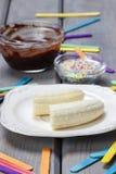 Preparing chocolate dipped bananas dessert Royalty Free Stock Images