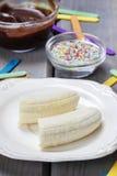 Preparing chocolate dipped bananas dessert Royalty Free Stock Image