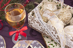 Preparing for christmas. A glass of wine with bulbs Royalty Free Stock Image
