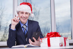 Preparing for Christmas. Caucasian Man preparing holiday gifts. For Christmas and New Year Royalty Free Stock Images