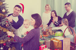 Preparing for Christmas celebration. Parents with kids and grandparents preparing for Christmas celebration stock images