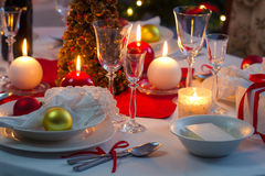 Preparing for Christmas Eve at beautifully decorated table Royalty Free Stock Image