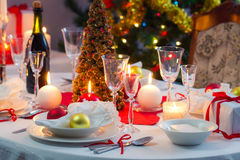Preparing for Christmas Eve at beautifully decorated table Stock Images