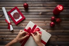 Preparing Christmas gift Stock Images