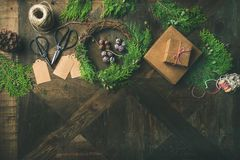 Preparing for Christmas or New Year. Flatlay of holiday decorations. Preparing for Christmas or New Year holiday. Flatlay of fur tree branches, gift boxes Stock Image