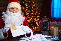 Preparing Christmas surprise Stock Images