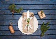 Preparing Christmas table setting with christmas decorations. To royalty free stock images
