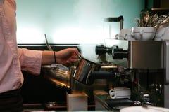 Preparing coffee. Preparing milk foam with espresso machine Stock Image