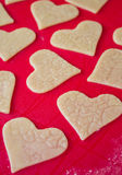 Preparing cookies. Preparing  heart  cookies on a silicone mat Stock Photos