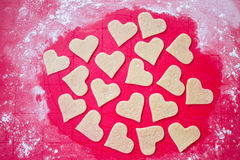 Preparing cookies. Preparing  heart  cookies on a silicone mat Royalty Free Stock Photos